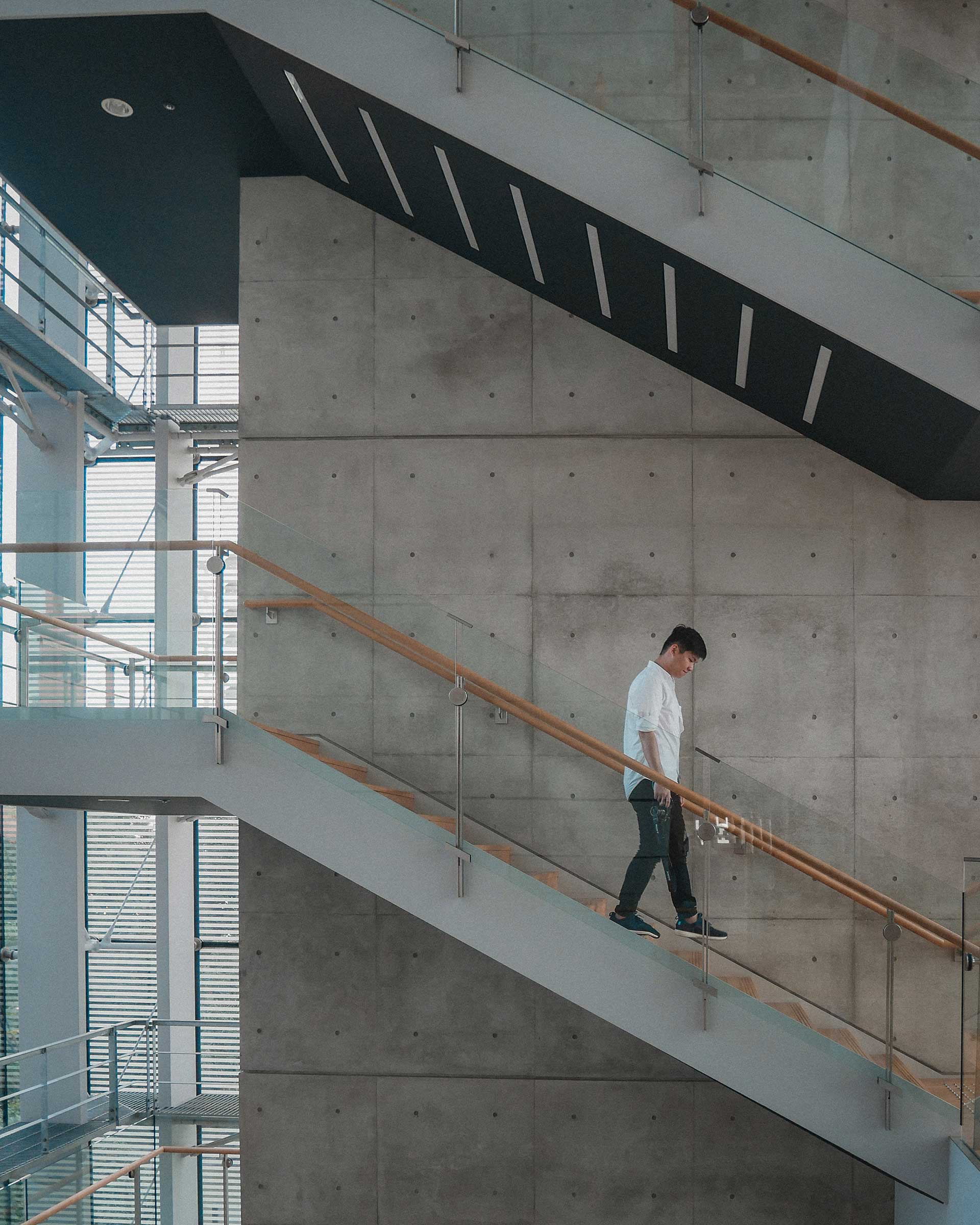 Me walking down a staircase in The National Art Center, Tokyo (国立新美術館)